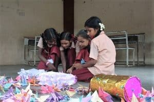 Students at a municipality school make paper cranes to wish upon.